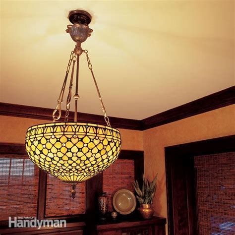 how to hang a ceiling light fixture how to hang a ceiling light fixture the family handyman