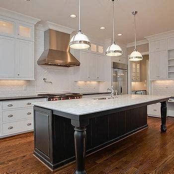kitchen island leg black kitchen island with black marble countertops transitional kitchen