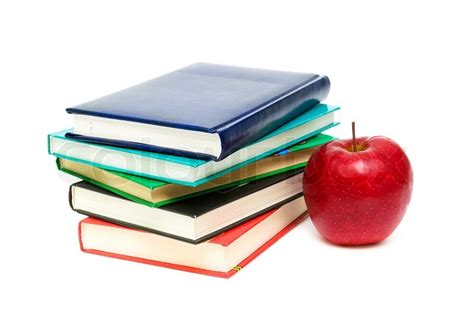 apple picture book stack of books and apple closeup isolated on white
