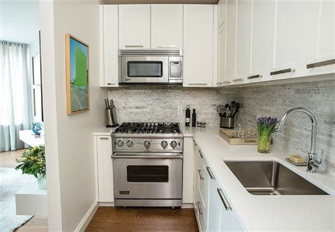 white paint kitchen cabinets painting laminate cabinets dos and don ts bob vila