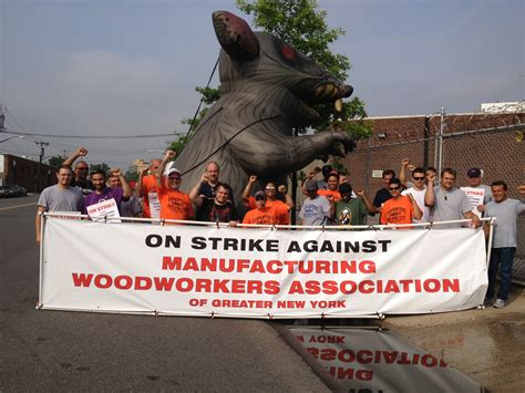 woodworkers association carpenters continue strike against manufacturing