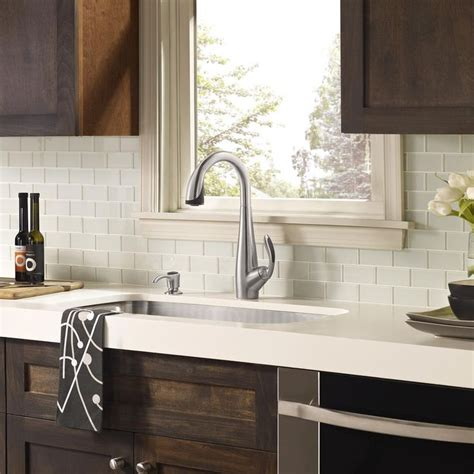 white glass tile backsplash white countertop with wood cabinets kitchens
