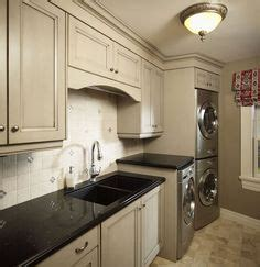 built ins with flipper doors to hide washer and dryer