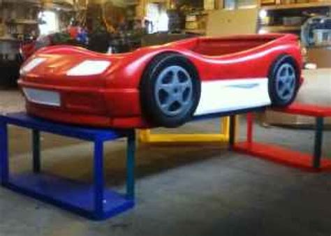 blue tikes car bed painted to look like lightning mcqueen baby and kid stuff