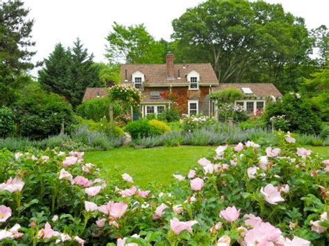 Cottage Garden With Pond, Gazebo And Vibrant Flowers