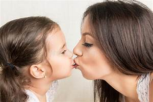 Happy Mother And Daughter Kissing Stock Photo - Image of ...
