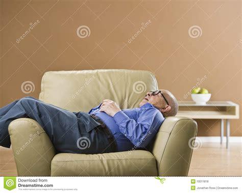 Senior Man Sleeping On Chair. Royalty Free Stock Photos   Image: 10011818