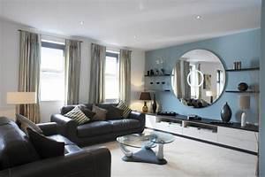 Moderne Wandspiegel Wohnzimmer : wandspiegel rund und elegant sch ne hinzuf gung an der wand ~ Markanthonyermac.com Haus und Dekorationen