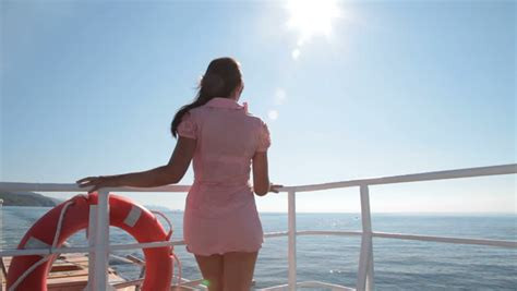 Boat Xvideos young woman relaxing on the deck of the sailing ship stock