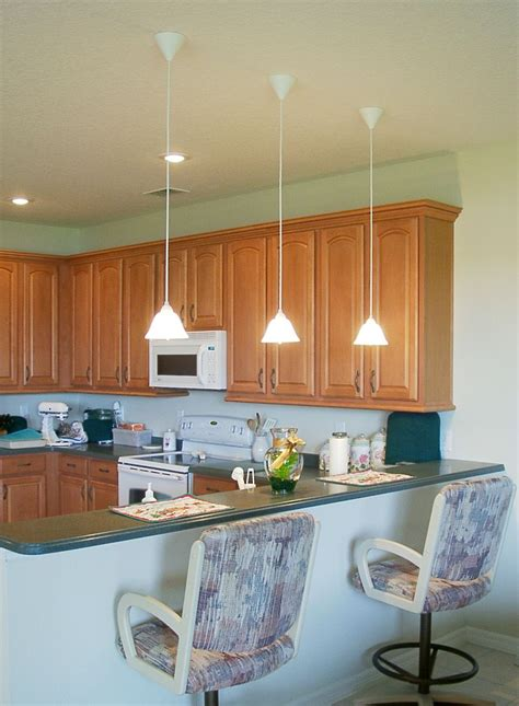 Low Hanging Mini Pendant Lights Over Kitchen Island For An