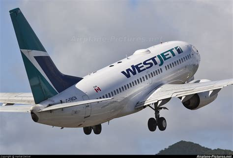 C-FWCN - WestJet Airlines Boeing 737-700 at Sint Maarten - Princess Juliana Intl | Photo ID ...