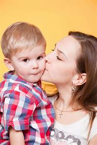 Happy Mom Kissing Little Son Stock Photography - Image ...