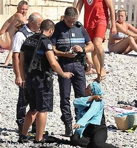 France: Armed police on French Riviera order Muslim woman ...