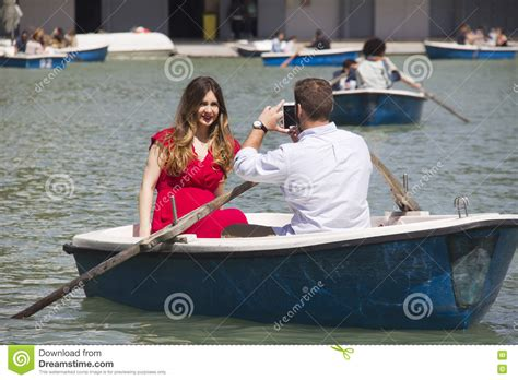 Boat In Spanish Rowing by Couple In Rowing Boat In Madrid Editorial Image