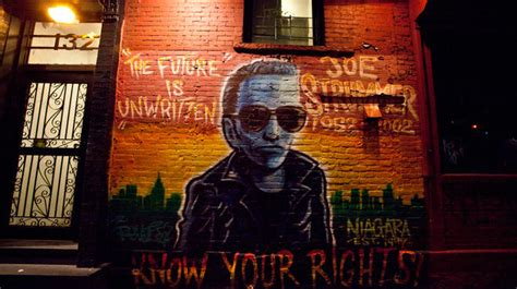 the joe strummer mural on 7th is back