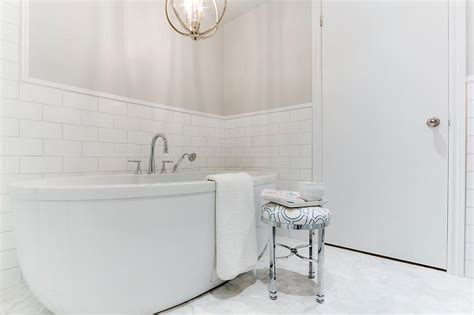 Bathroom With Gray Paint On Upper Walls And Subway Tiles