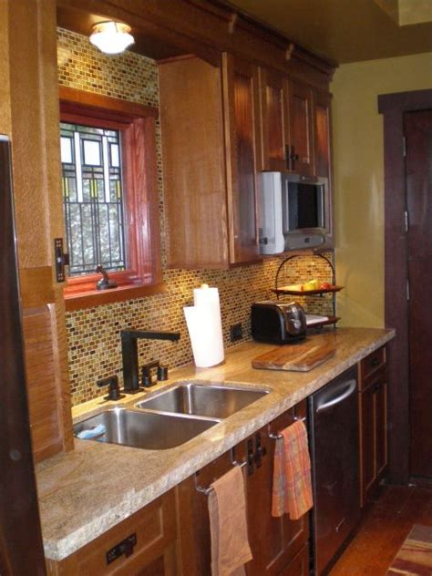 arts crafts style kitchen quarter sawn oak cabinets granite countertops glass tile backsplash