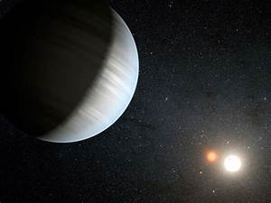 Double Planets Found Orbiting Twin Stars