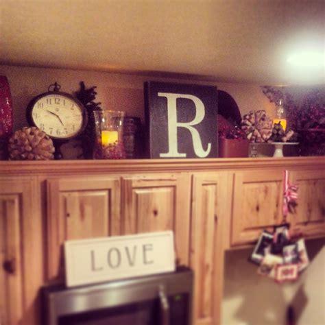 above kitchen cabinet decor above cabinet kitchen decor crafty mally home