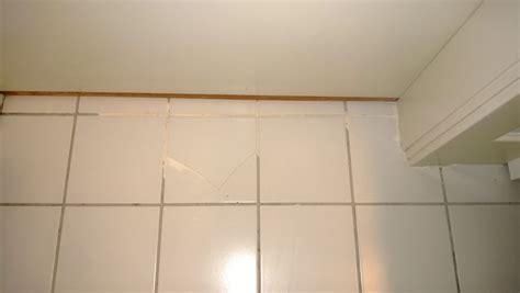 regrouting bathroom tile orbited by nine moons