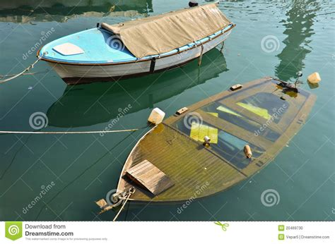 Dream Of Your Boat Sinking by Two Boats On Berth One Is Sinking Stock Photo Image