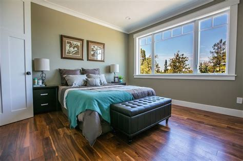 contemporary master bedroom with high ceiling crown