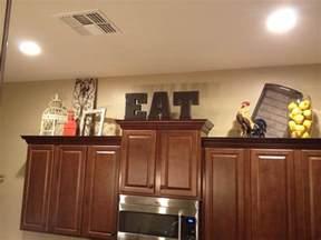 above kitchen cabinet decor above cabinet shabby chic decor home decor