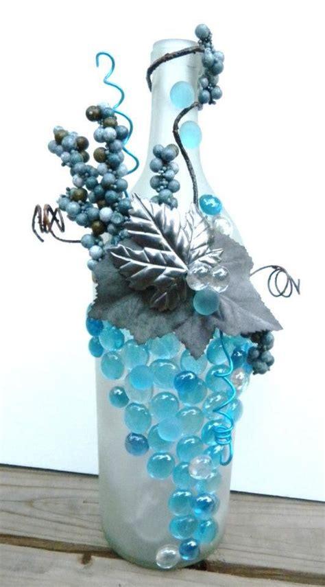 decorative embellished wine bottle light withturquoise