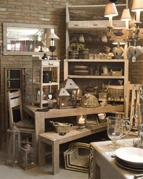 multi layers visual merchandising for a shabby chic home decor store shelving and tables make