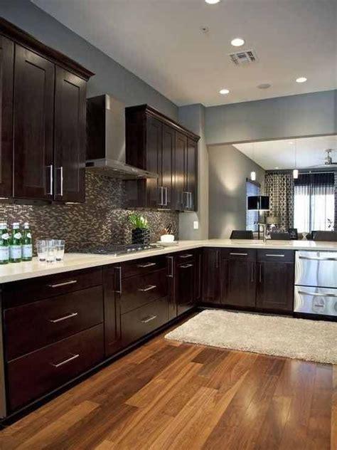 espresso cabinets light wood floors and light countertops kitchen ideas kitchen