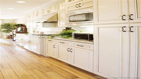 kitchen flooring with white cabinets antique white kitchen cabinets with light wood floors