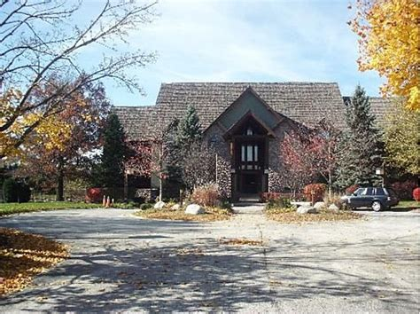 R. Kelly's Olympia Fields Mansion Sold To Isley Brother Carpet And Flooring Cushion Floor Hardwood Discount Calgary Wood Color Advice Cherry Vinyl Hgtv Dream Home Laminate For Damp Basement Sean Page Oak Suppliers Somerset