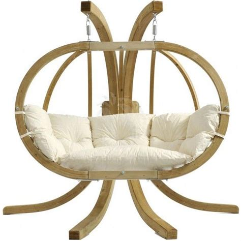 a hanging chair with stand located indoor mike davies s home interior furniture design