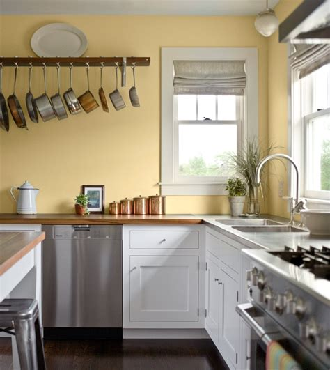 pale yellow walls white cabinets wood counter tops kitchen kitchen ideas