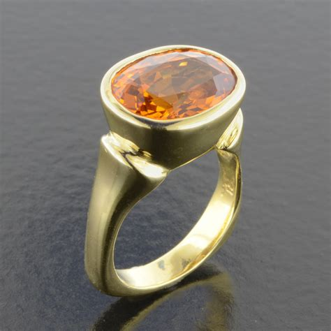 Mandarin Garnet Ring • Becky Thatcher Designs. Fashion Engagement Rings. Abstract Wedding Rings. Hidden Sapphire Engagement Rings. Marquise Cut Rings