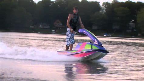 Jet Ski Boat Youtube by Stand Up Jetski Jumping The Wake Behind Boat Youtube