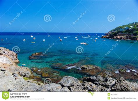 Boat In The Water In Spanish by Cove Costa Brava Spain Royalty Free Stock Photography