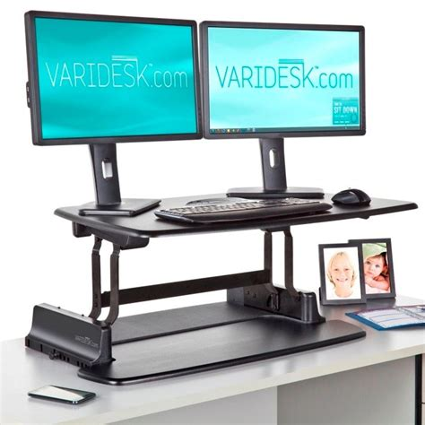 varidesk pro dual monitor 300 and you don t to buy a new desk to work standing up