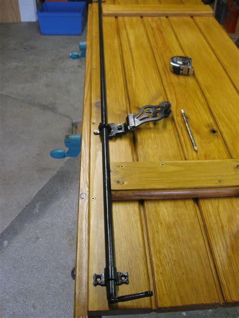 mecanisme fermeture volet bois