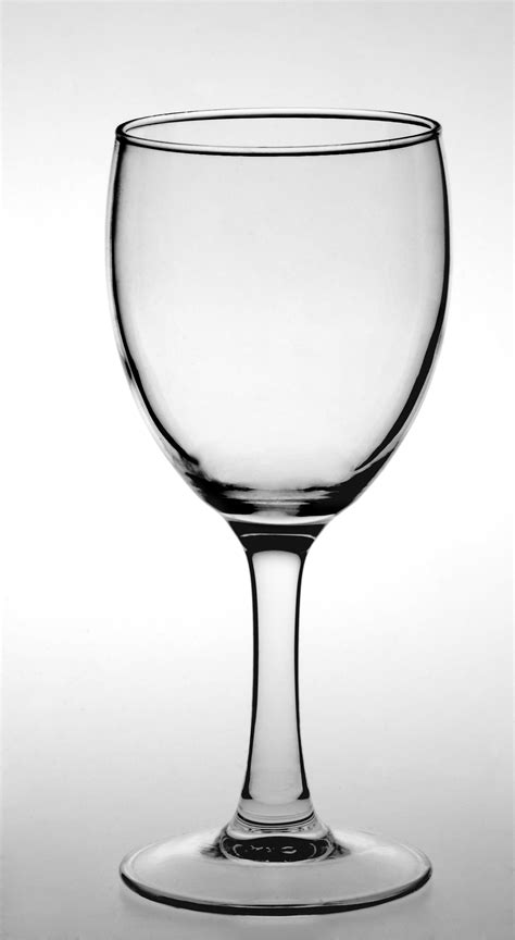 Closeup Of Wine Glass Against White Background · Free