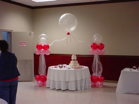 simple ballon decoration with sweet cake side simple glass on table side unique door plus