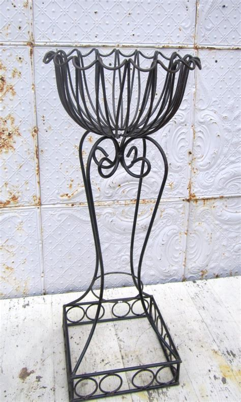 Wrought Iron Dee Dee Circle Plant Stand Pot Holder. Horizon Floors. Cortina Tile. Mexican Style Homes. 84 Dining Table. Spa Shower. Amerock. Bench For Dining Table. Gates And Fences