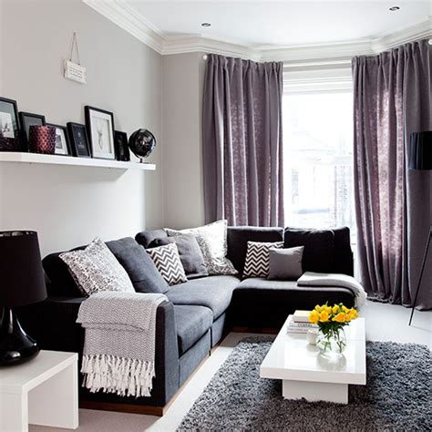 grey and purple living room walls grey traditional living room with purple soft furnishings