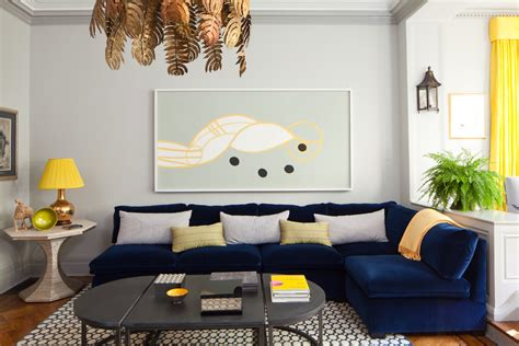 Navy Blue Sofa Living Room Contemporary With Abstract Art Spanish Baby Shower Invitation Wording Favor For Boy African Safari Theme Time Capsule Venues Austin Tx Interactive Games Tea Party Themed Decorations Monster Ideas