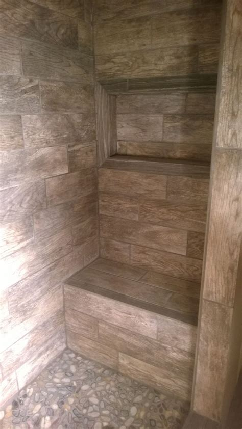 master shower with bench and window for soap shoo