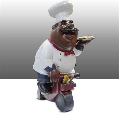 black chef kitchen statue on bike table decor