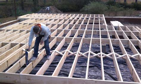 2x10 floor joist 16oc with cross bracing 6 mil poly vapor barrier yelp