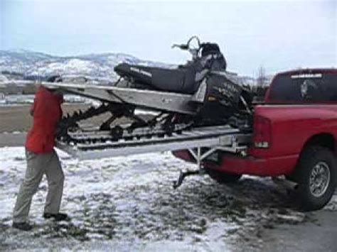 sled deck assembly and snowmobile loading