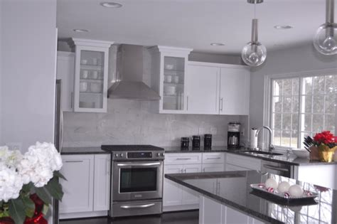 white kitchen cabinets with gray granite countertops grey