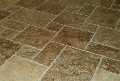 tuscany walnut travertine tile in a versailles pattern sold in 16 sq ft sets for 154 56